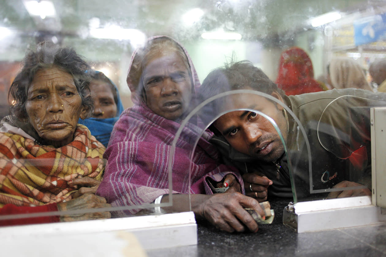 Passengers wait to purchase tickets at a reservation counter in Allahabad, India.