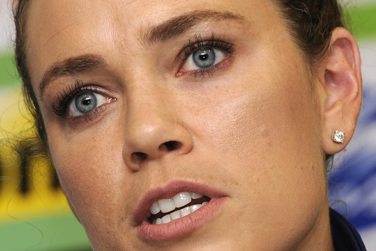 US swimmer Natalie Coughlin talks during a press conference on the eve of the start of the swimming competition at the FINA World Championships in the indoor stadium of the Oriental Sports Centre in Shanghai on July 23, 2011.   AFP PHOTO / PHILIPPE LOPEZ (Photo credit should read PHILIPPE LOPEZ/AFP/Getty Images)