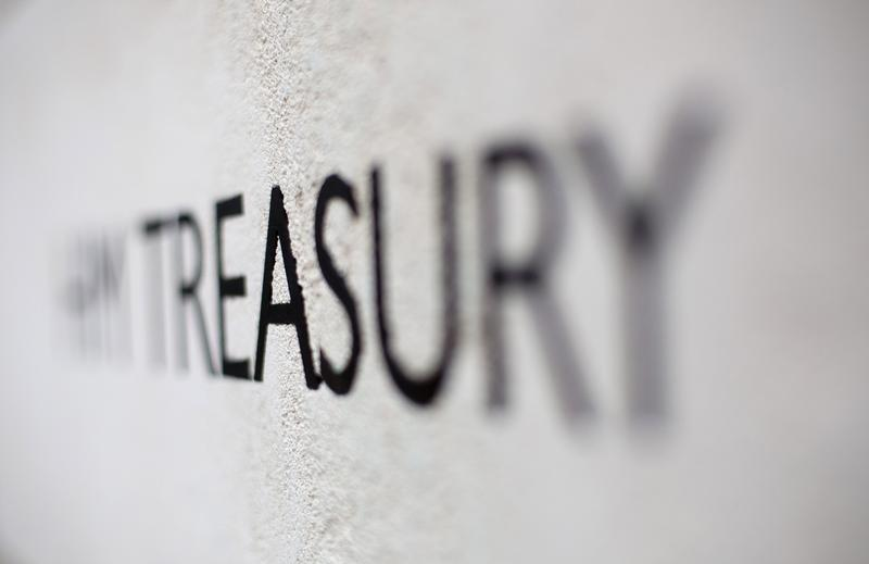 The HM Treasury name is seen painted on the outside of Britain's Treasury building in central London