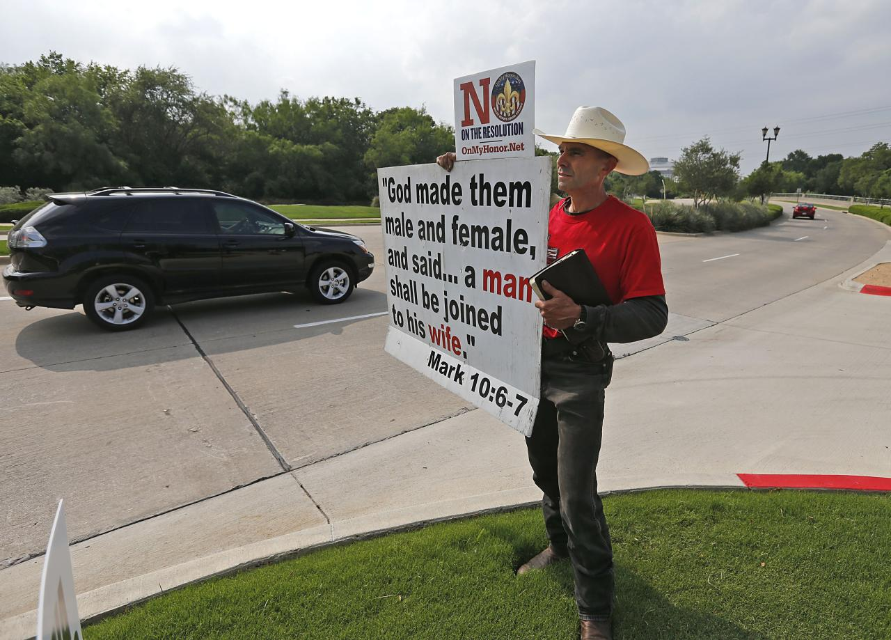 GRAPEVINE, TX - MAY 23:  Alan Hoyle, of Lincolnton, North Carolina holds up a sign opposing gays in the Boy Scouts at the Gaylord Texan Resort and Convention Center May 23, 2013 in Grapevine, Texas, The Boy Scouts of America today ended its policy of prohibitting openly gay youths from participating in Scout activities, while leaving intact its ban on gay adults and leaders. (Photo by Stewart F. House/Getty Images)