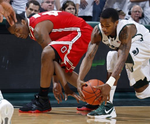 Michigan State's Keith Appling, right, gets a steal against Ohio State's William Buford during the first half of an NCAA college basketball game, Sunday, March 4, 2012, in East Lansing, Mich. (AP Photo/Al Goldis)