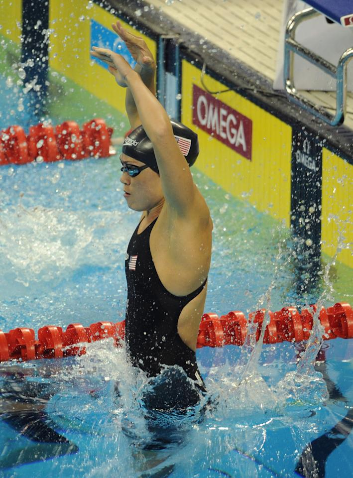 US swimmer Natalie Coughlin jumps in the water prior to compete in the final of the women's 4x100-metre medley relay swimming event in the FINA World Championships at the indoor stadium of the Oriental Sports Center in Shanghai on July 30, 2011. The United States won gold.  AFP PHOTO / MARK RALSTON (Photo credit should read MARK RALSTON/AFP/Getty Images)