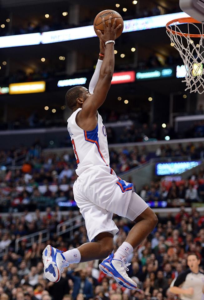 LOS ANGELES, CA - DECEMBER 19:  Chris Paul #3 of the Los Angeles Clippers scores on a dunk against the New Orleans Hornets during a 93-77 Clipper victory for their 11th straight win at Staples Center on December 19, 2012 in Los Angeles, California.  NOTE TO USER: User expressly acknowledges and agrees that, by downloading and or using this photograph, User is consenting to the terms and conditions of the Getty Images License Agreement.  (Photo by Harry How/Getty Images)