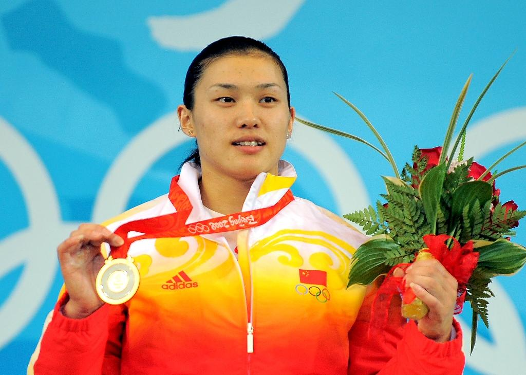 Cao Lei, the 75kg weighlifting champion of the 2008 Beijing Olympics, was one of three Chinese women stripped of their weightlifting gold medals for doping (AFP Photo/JUNG YEON-JE)