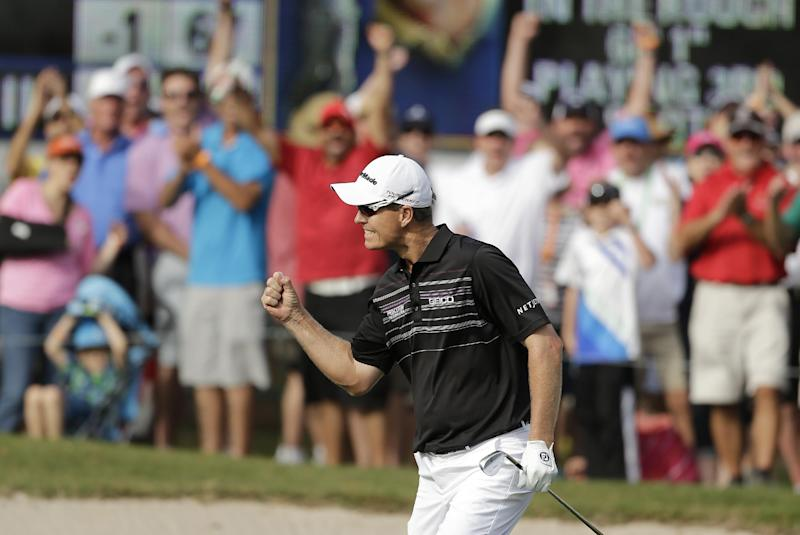 John Senden, of Australia, celebrates after chipping in on the 16th hole during the final round of the Valspar Championship golf tournament at Innisbrook, Sunday, March 16, 2014, in Palm Harbor, Fla. Senden won the tournament