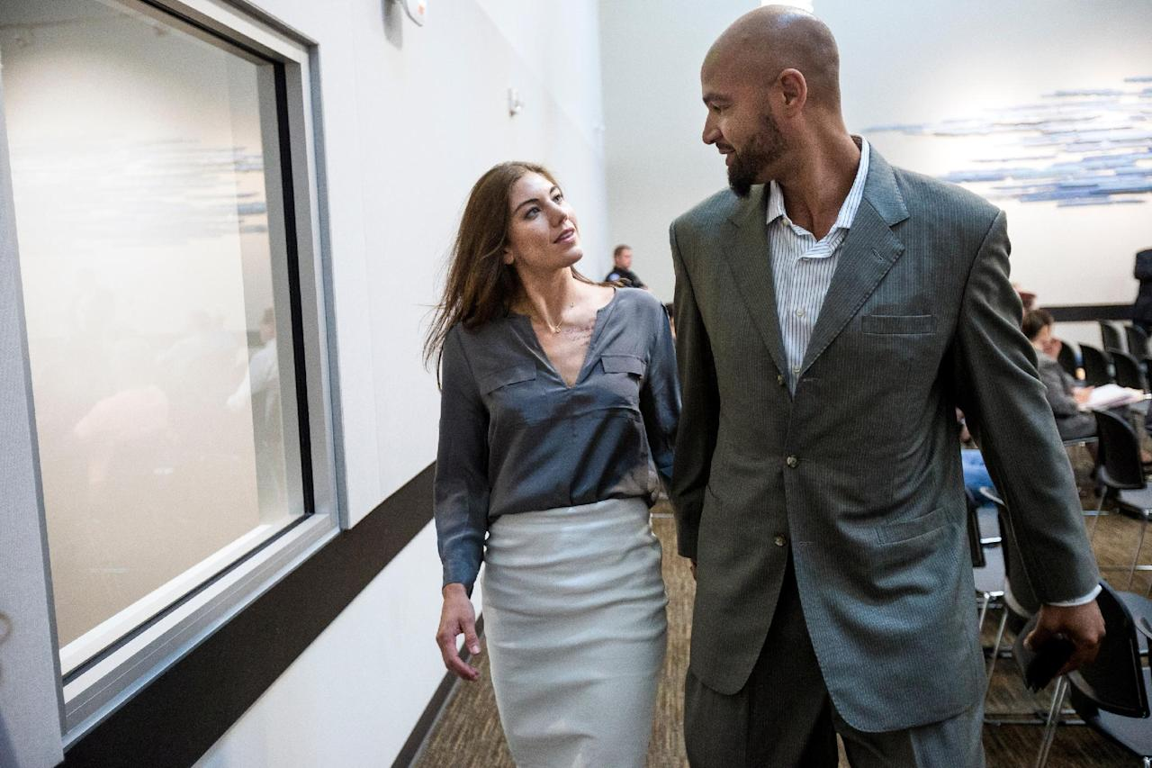 U.S. soccer star Hope Solo and her husband, former Seahawks tight end Jerramy Stevens, leaves the Kirkland Municipal Court in Kirkland, Wash., Monday, Aug. 11, 2014. (AP Photo/seattlepi.com, Jordan Stead) NO SALES; MAGS OUT; SEATTLE TIMES OUT MAGS OUT; MANDATORY CREDIT; TV OUT