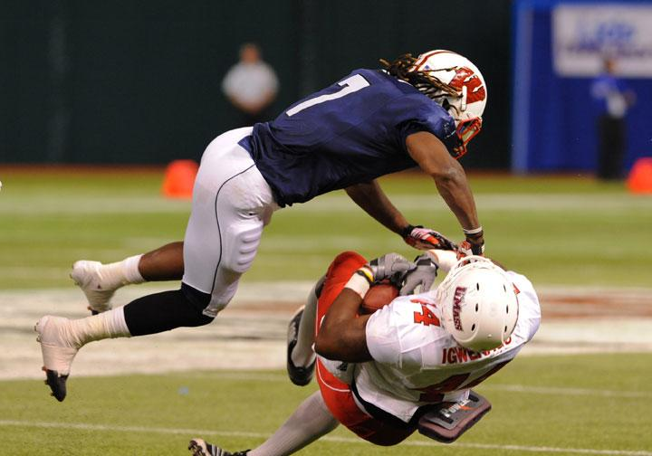 ST. PETERSBURG, FL - JANUARY 21: Defensive back Aaron Henry #7 of the Wisconsin Badgers tackles  tight end Emil Igwenagu #44 of the University of Massachuttes Minutemen during the 87th annual East-West Shrine game January 21, 2012 at Tropicana Field in St. Petersburg, Florida. (Photo by Al Messerschmidt/Getty Images)