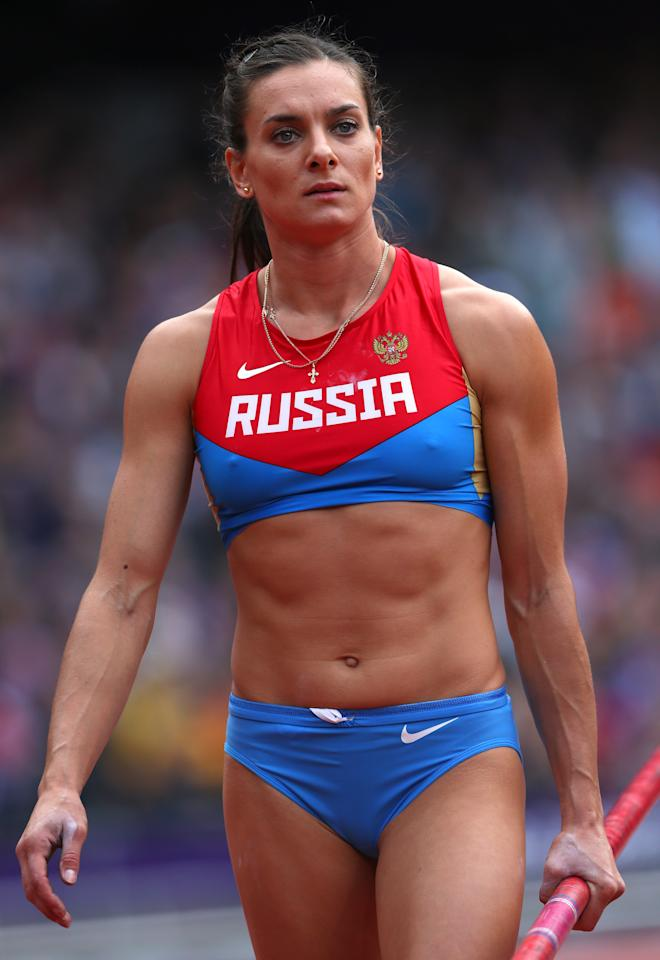 Elena Isinbaeva of Russia competes in the Women's Pole Vault qualification on Day 8 of the London 2012 Olympic Games at Olympic Stadium on August 4, 2012 in London, England.  (Photo by Alexander Hassenstein/Getty Images)