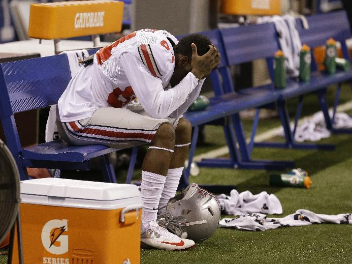 Ohio State's Corey Smith reacts on the bench near the end the Big Ten Conference championship NCAA college football game against Michigan State Saturday Dec. 7, 2013, in Indianapolis. Michigan State defeated Ohio State, 34-24. (AP Photo/Michael Conroy)