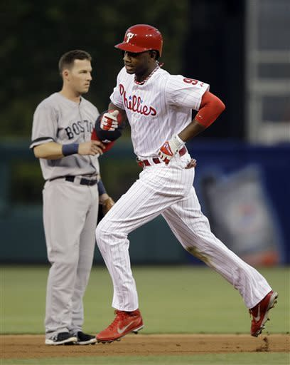 Brown homers twice, slugs Phillies past Red Sox