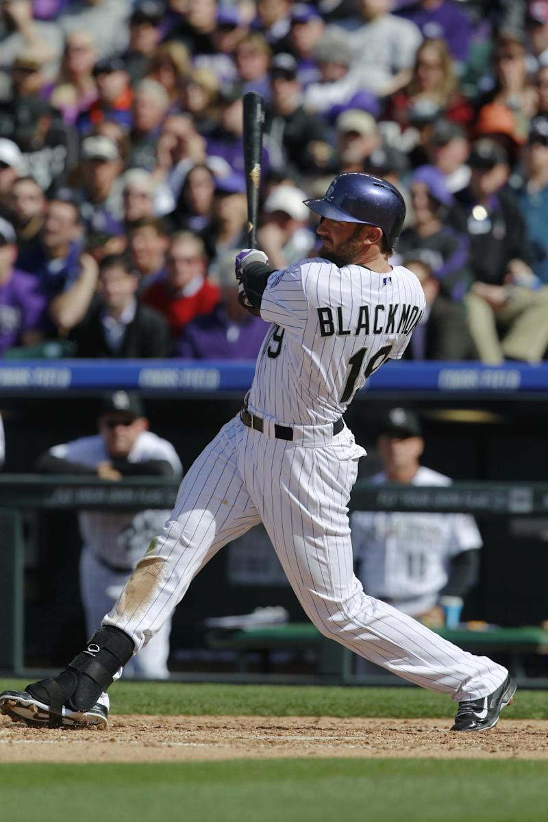 Blackmon leads Rox past D-Backs in home opener