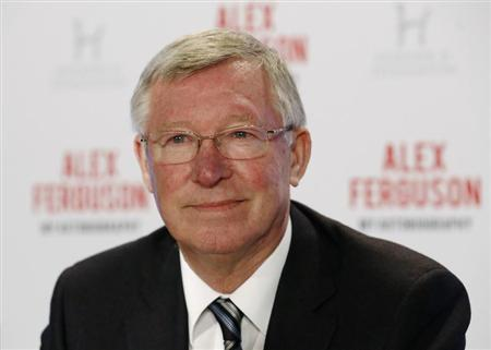 Former Manchester United manager Alex Ferguson poses before a news conference in London