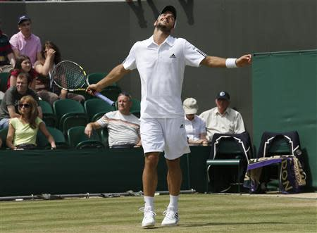 Viktor Troicki of Serbia reacts after losing advantage in his men's singles tennis match against Mikhail Youzhny of Russia at the Wimbledon Tennis Championships, in London