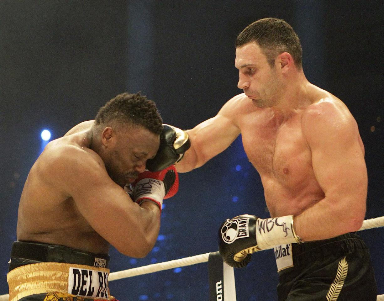 WBC heavyweight Champion Vitali Klitschko of Ukraine, right, fights with challenger Dereck Chisora of Britain during their WBC heavyweight title boxing bout at the Olympic hall in Munich, Germany , Saturday, Feb. 18, 2012. (AP Photo/Frank Augstein)