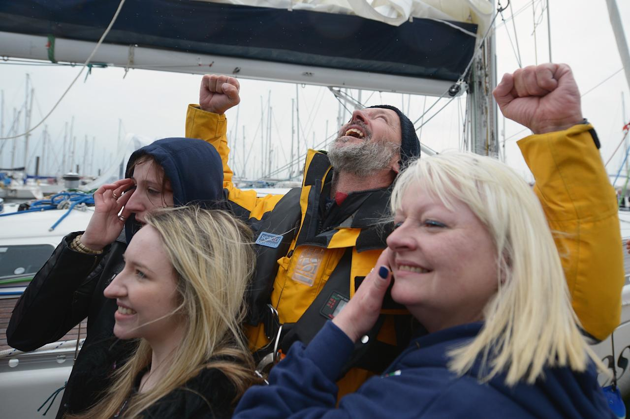 TROON, SCOTLAND - MAY 08:  Gerry Hughes is greeted by his wife Kathleen and two daughters Nicola and Ashley after sailing his yacht Quest III back into Troon Marina on May 8, 2013 in Troon,Scotland. The 55 year old sailor from Glasgow is the first deaf person to sail single handed around the world, he was greeted back in Scotland by a crowd of  around 300 people.  (Photo by Jeff J Mitchell/Getty Images)