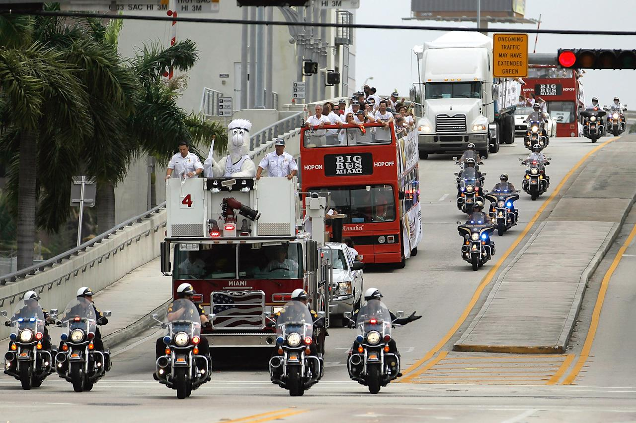 MIAMI, FL - JUNE 25:  Miami Heat players, coaches and supporters are seen as they arrive on double decker buses for the start of a victory parade through the streets during a celebration for the 2012 NBA Champion Miami Heat on June 25, 2012 in Miami, Florida. The Heat beat the Oklahoma Thunder to win the NBA title.  (Photo by Joe Raedle/Getty Images)
