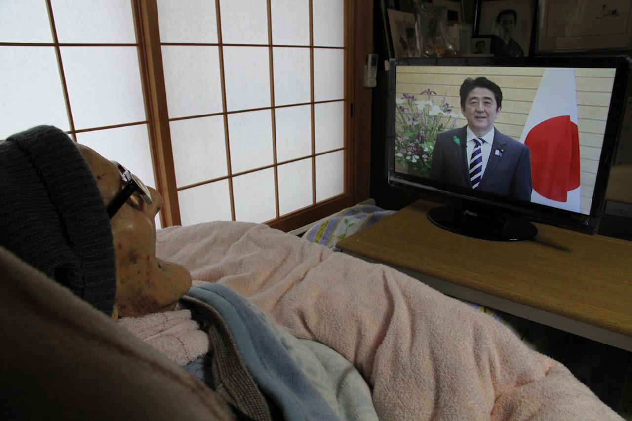 KYOTANGO, JAPAN - APRIL 19:  In this handout image provided by Kyotango City government, the world's oldest person Jiroemon Kimura watches a video message from Japanese Prime Minister Shinzo Abe as he celebrates his 116th birthday at his home on April 19, 2013 in Kyotango, Kyoto, Japan. Kimura was born in 1897, has 7 children, 14 grandchildren, 25 great-grandchildren and 14 great-great-grandchildren.  (Photo by Kyotango City Government via Getty Images)