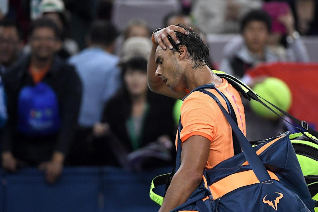 Rafael Nadal of Spain leaves after the men's singles match against Viktor Troicki of Serbia at the Shanghai Masters tennis tournament in Shanghai on October 12, 2016. (AFP Photo/WANG ZHAO)