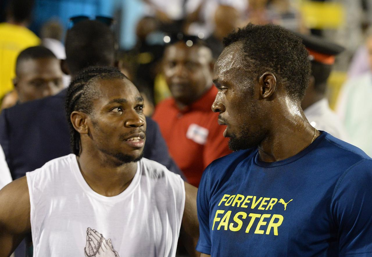 <p> FILE - In this June 11, 2016, file photo, Usain Bolt, right, of Jamaica, speaks with compatriot Yohan Blake after the 100-meter final at the Racers Grand Prix track and field event at the National Stadium in Kingston, Jamaica. The most dominant runner at Jamaica's national track and field championships this summer was not a superstar sprinter like Usain Bolt, Yohan Blake or Veronica Campbell-Brown. It was Kemoy Campbell. (AP Photo/Collin Reid, File) </p>