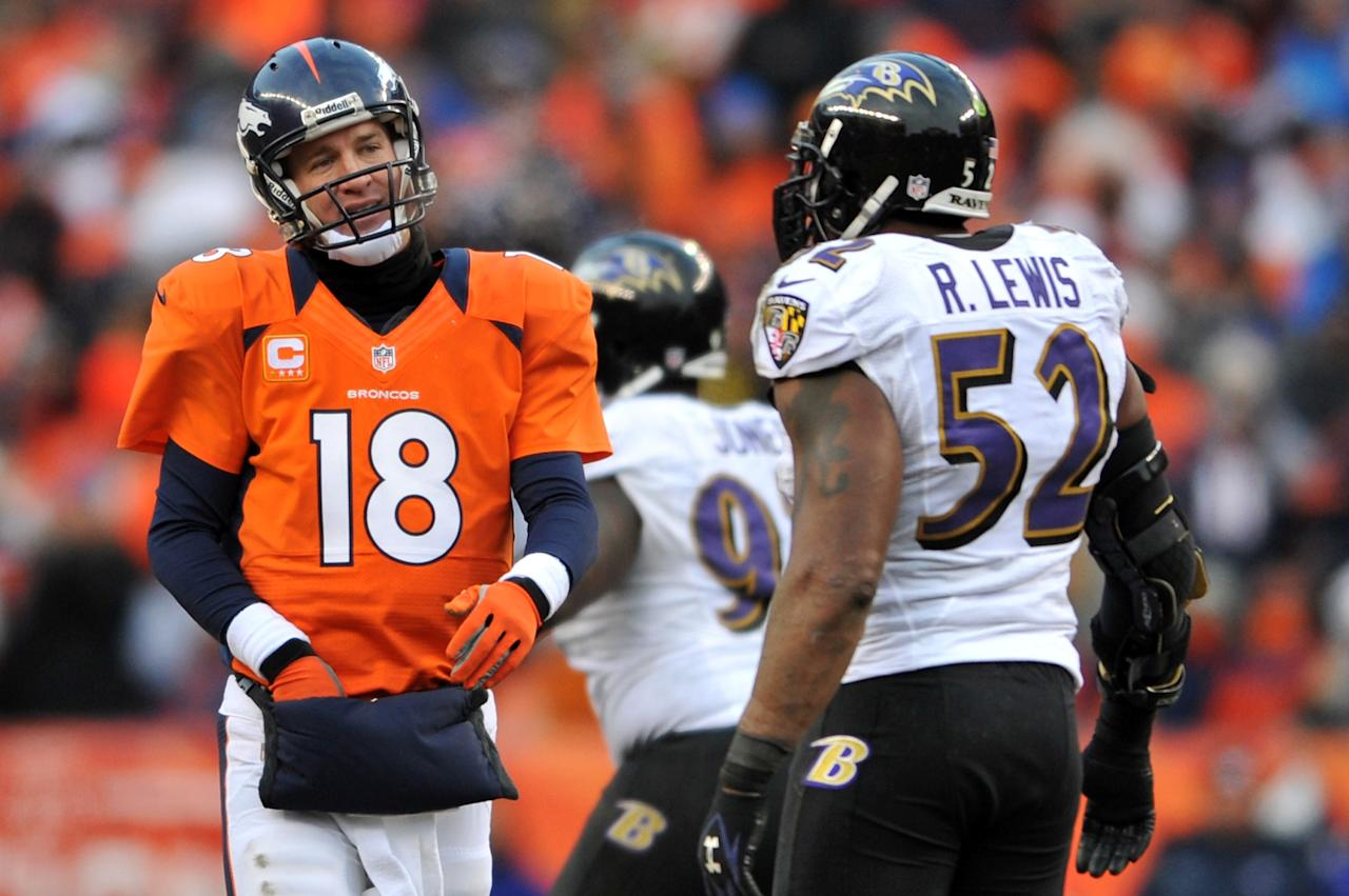 DENVER, CO - JANUARY 12:  Peyton Manning (L) #18 of the Denver Broncos stnads on the field next to Ray Lewis #52 of the Baltimore Ravens during the AFC Divisional Playoff Game at Sports Authority Field at Mile High on January 12, 2013 in Denver, Colorado.  (Photo by Dustin Bradford/Getty Images)