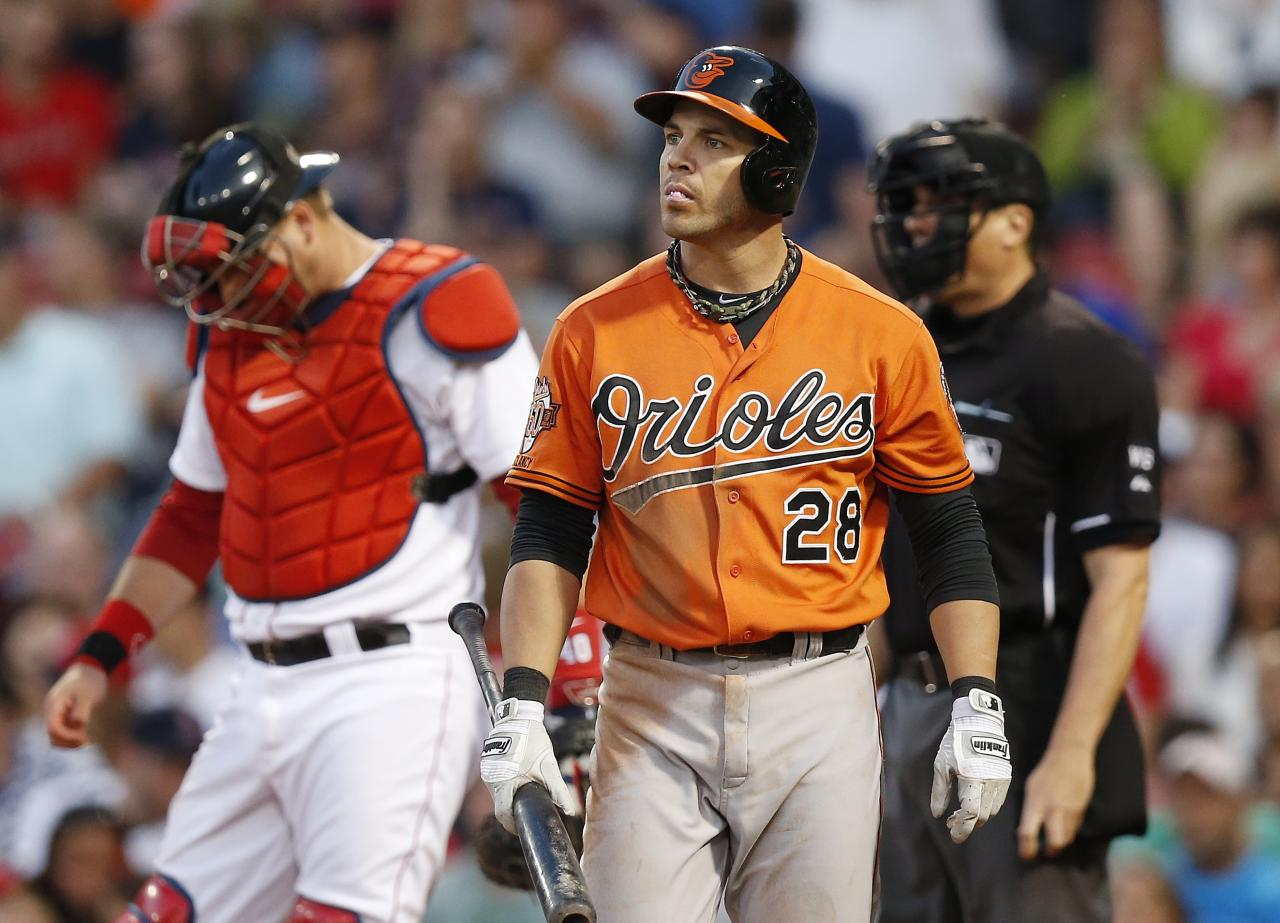 Baltimore Orioles' Steve Pearce (28) walks to the dug out in front of Boston Red Sox's A.J. Pierzynski, left, after striking out in the third inning of the second game of a baseball doubleheader in Boston, Saturday, July 5, 2014. (AP Photo/Michael Dwyer)