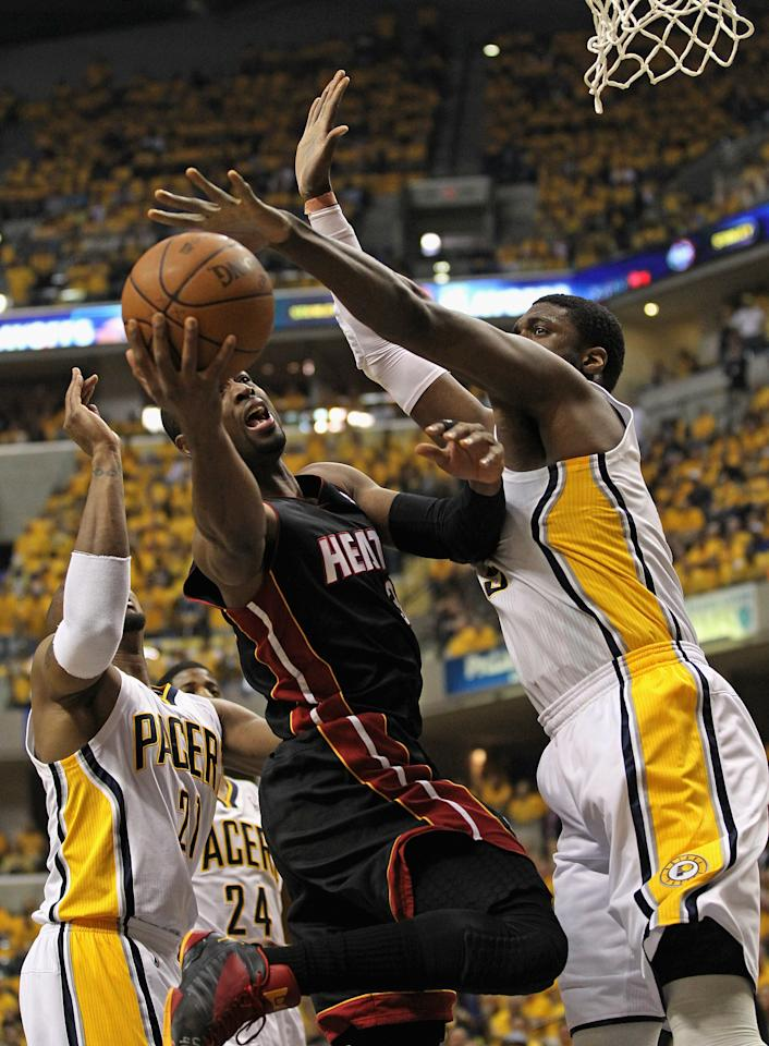 INDIANAPOLIS, IN - MAY 24: Dwyane Wade #3 of the Miami Heat shoots between David West #21 and Roy Hibbert #55 of the Indiana Pacers in Game Six of the Eastern Conference Semifinals in the 2012 NBA Playoffs at Bankers Life Fieldhouse on May 24, 2012 in Indianapolis, Indiana. NOTE TO USER: User expressly acknowledges and agrees that, by downloading and/or using this photograph, User is consenting to the terms and conditions of the Getty Images License Agreement. (Photo by Jonathan Daniel/Getty Images)