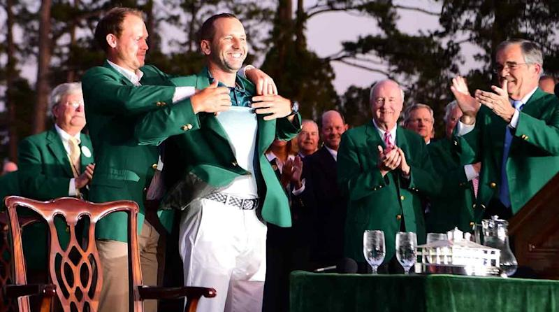 Danny Willett slips the green jacket on Sergio Garcia, the newest Masters champion.
