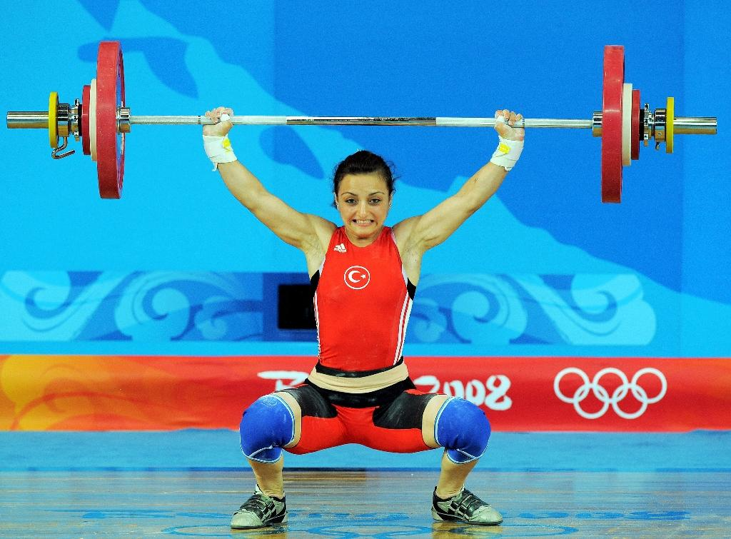 Sibel Ozkan of Turkey competes in the women's 48kg weightlifting event during the 2008 Beijing Olympic Games at the Beijing University of Aeronautics and Astronautics Gymnasium in Beijing on August 9, 2008 (AFP Photo/Jung Yeon-Je)