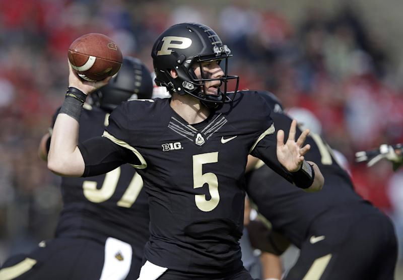 In this Nov. 2, 2013, file photo, Purdue quarterback Danny Etling throws against Ohio State during the first half of an NCAA college football game in West Lafayette, Ind