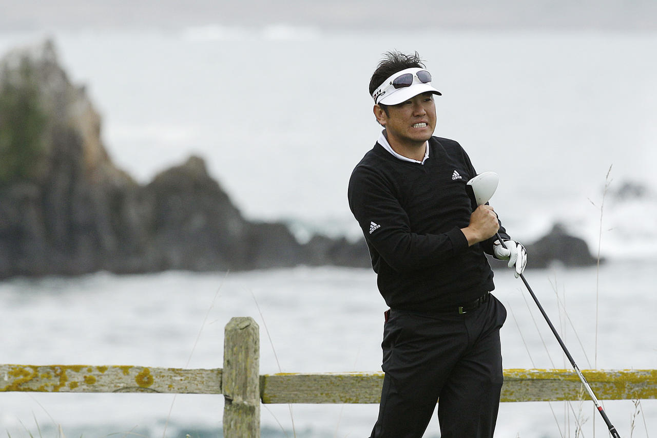 Charlie Wi reacts as he follows his shot off the 18th tee of the Pebble Beach Golf Links during the second round of the AT&T Pebble Beach National Pro-Am golf tournament, Friday, Feb. 10, 2012, in Pebble Beach, Calif. (AP Photo/Ben Margot)