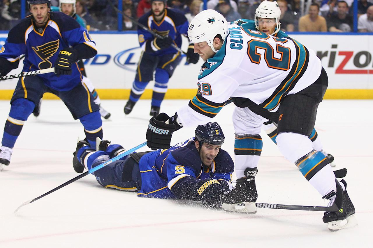 ST. LOUIS, MO - APRIL 14: Barret Jackman #5 of the St. Louis Blues defends against a shot on goal by Ryane Clowe #29 of the San Jose Sharks during Game Two of the Western Conference Quarterfinals during the 2012 NHL Stanley Cup Playoffs at the Scottrade Center on April 14, 2012 in St. Louis, Missouri.  (Photo by Dilip Vishwanat/Getty Images)