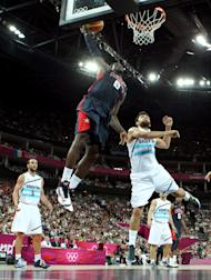 LeBron James goes up for a dunk over Carlos Delfino during the Men's Basketball semifinal (Getty Images)