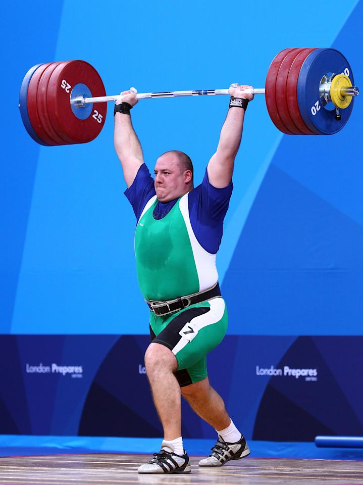 LONDON, ENGLAND - DECEMBER 11: Peter Nagy of Hungary makes a lift in the Men's 105kg during the Weightlifting LOCOG Test Event for London 2012 at ExCel on December 11, 2011 in London, England. (Photo by Julian Finney/Getty Images)