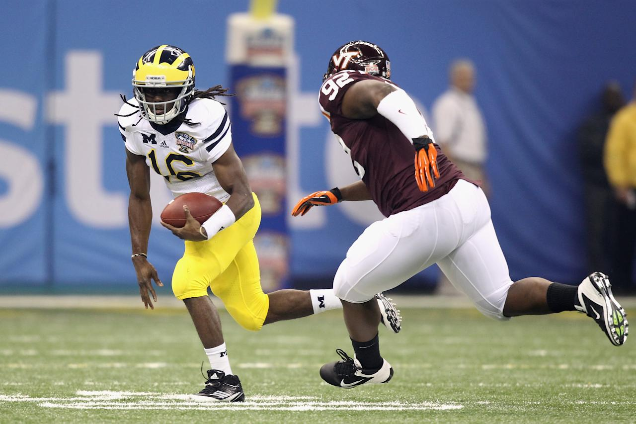 NEW ORLEANS, LA - JANUARY 03:  Denard Robinson #16 of the Michigan Wolverines runs the ball in the first quarter against the Luther Maddy #92 of the Virginia Tech Hokies during the Allstate Sugar Bowl at Mercedes-Benz Superdome on January 3, 2012 in New Orleans, Louisiana.  (Photo by Matthew Stockman/Getty Images)