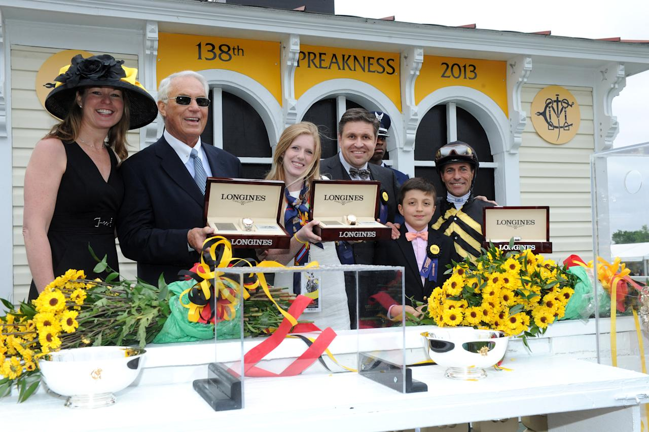 IMAGE DISTRIBUTED FOR LONGINES - Juan Carlos-Capelli, center, with his son Thomas, and Jennifer Judkins, left, both of Longines, award trainer D. Wayne Lukas, second left, jockey Gary Stevens, right, and Erin Kelley, daughter of owner Brad Kelley, with their Longines St. Imier chronographs after their horse Oxbow won the 138th Preakness Stakes, Saturday, May 18, 2013, in Baltimore, MD. Longines, the Swiss watchmaker known for its famous timepieces, is the Official Watch and Timekeeper of the 138th annual Preakness Stakes. (Diane Bondareff/Invision for Longines/AP Images)