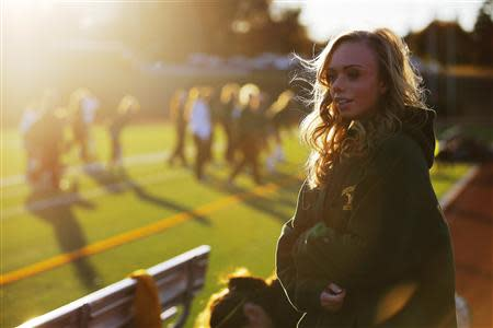 Hannah Steenhuysen watches her high school's girls soccer team prepare for a game against Bishop Feehan in Attleboro