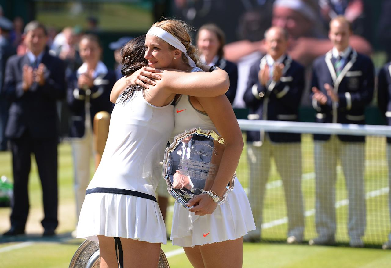 France's Marion Bartoli (left) hugs Germany's Sabine Lisicki after winning the Ladies' Singles Final during day twelve of the Wimbledon Championships at The All England Lawn Tennis and Croquet Club, Wimbledon.