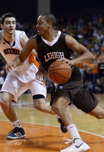 Lehigh's C.J. McCollum (3) moves around a Bucknell defender during the first half of an NCAA college basketball game in the men's Patriot League tournament title matchup in Lewisburg, Pa., on Wednesday, March 7, 2012. (AP Photo/Ralph Wilson)