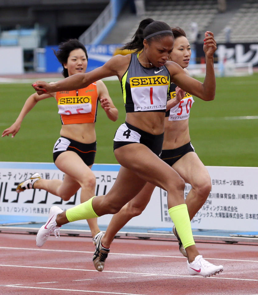 FILE - This May 6, 2012 file photo shows Allyson Felix of the United States, (1), crosses the finish line ahead of Chisato Fukushima, of Japan, (50), and Anna Doi of Japan, left, during the Women's 100-meter race at the Golden Grand Prix in Kawasaki, Japan. If Felix is looking for advice about whether to try the 200-400 double at the Olympics, Michael Johnson has a message for her: Don't bother. (AP Photo/Shizuo Kambayashi, File)