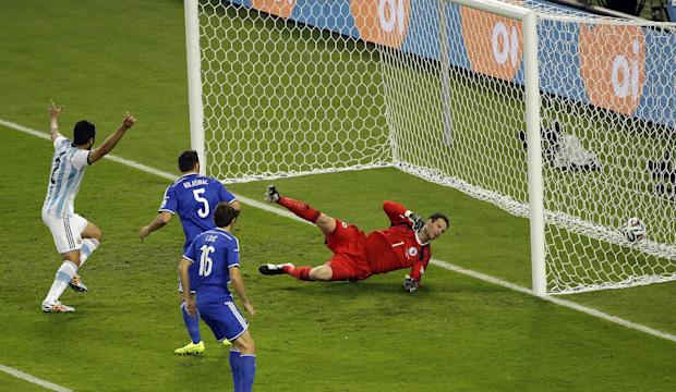 Bosnia's Sead Kolasinac, 5, scores an own goal to give Argentina a 1-0 lead during the group F World Cup soccer match between Argentina and Bosnia at the Maracana Stadium in Rio de Janeiro, Brazil, Sunday, June 15, 2014. (AP Photo/Sergei Grits)