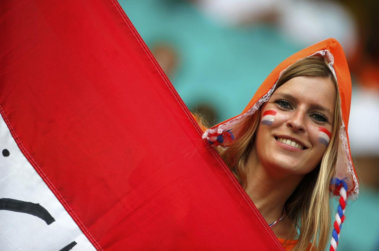 A Netherlands fan poses before the 2014 World Cup quarter-finals between Costa Rica and the Netherlands at the Fonte Nova arena in Salvador July 5, 2014. REUTERS/Sergio Moraes (BRAZIL - Tags: SOCCER SPORT WORLD CUP)