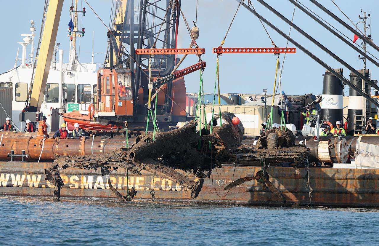 RAMSGATE, ENGLAND - JUNE 10:  Workers watch as a World War II Dornier 17 aircraft is lifted from waters of the English Channel on June 10, 2013 near Ramsgate, England. The salvage is planned through the RAF Museum to lift the only remaining German bomber Dornier 17, used during the 'Battle of Britain' of 1940. The plane on the Goodwin Sands is believed to be aircraft call-sign 5K-AR, shot down on August 26, 1940 at the height of the battle by RAF Boulton-Paul Defiant fighters. The Project has suffered many delays due to poor weather. Once recovered, the aircraft will be preserved and put on displayed for the public at the museum's Hendon base in north London.  (Photo by Peter Macdiarmid/Getty Images)