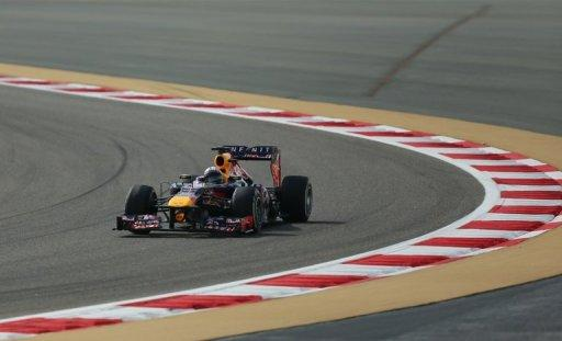 Red Bull Racing's German driver Sebastian Vettel drives at the Bahrain International Circuit in Manama on April 21, 2013, during the Bahrain Formula One Grand Prix. Vettel took the chequered flag
