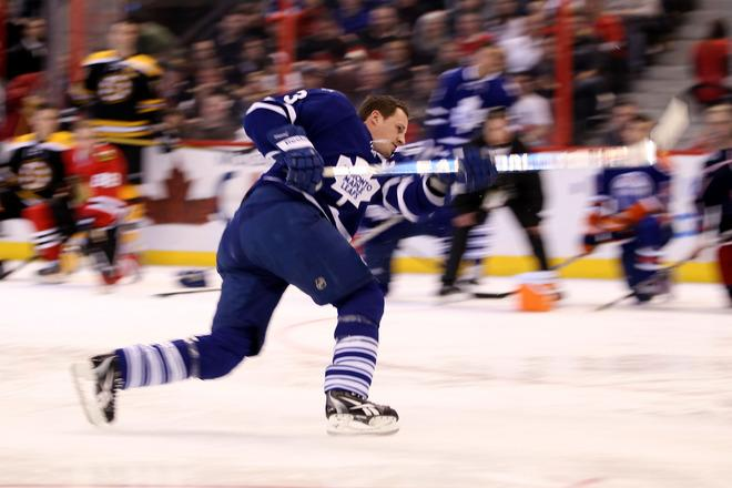 OTTAWA, ON - JANUARY 28:  Dion Phaneuf #3 of the Toronto Maple Leafs and team Chara takes a shot during the Blackberry NHL Hardest Shot part of the 2012 Molson Canadian NHL All-Star Skills Competition at Scotiabank Place on January 28, 2012 in Ottawa, Ontario, Canada.  (Photo by Christian Petersen/Getty Images)
