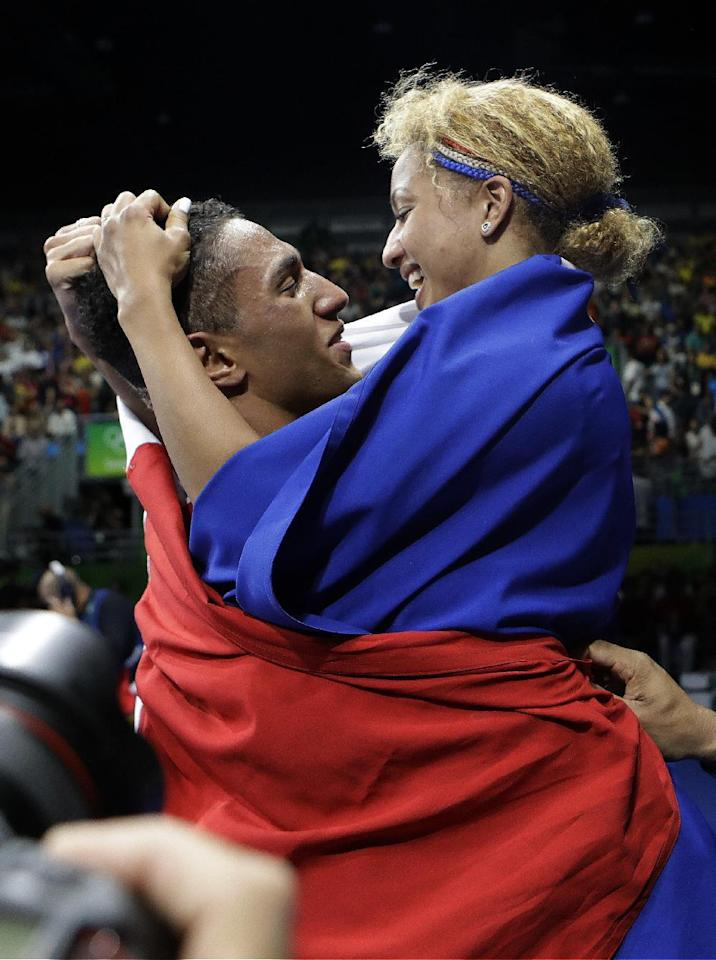 France's Tony Victor James Yoka, left, celebrates his gold medal for the men's super heavyweight over 91-kg boxing with Estelle Mossely, France's gold medalist for the women's lightweight 60-kg, at the 2016 Summer Olympics in Rio de Janeiro, Brazil, Sunday, Aug. 21, 2016. (AP Photo/Frank Franklin II)