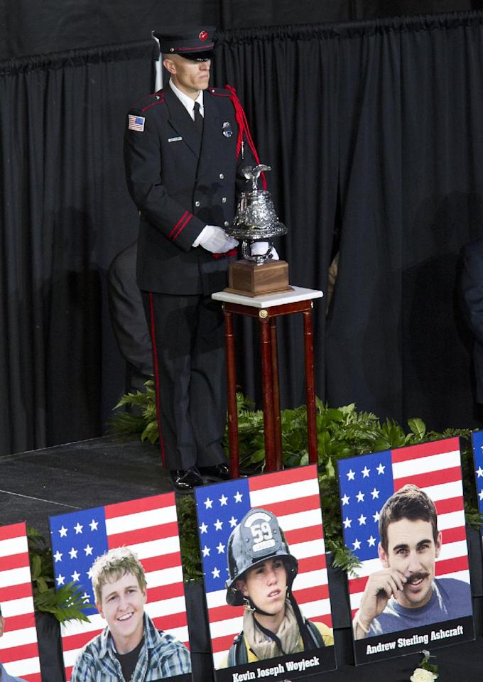 A bell is rung for each fallen firefighter during a memorial service for the 19 fallen firefighters at Tim's Toyota Center in Prescott Valley, Ariz. on Tuesday, July 9, 2013. Prescott's Granite Mountain Hotshots were overrun by smoke and fire while battling a blaze on a ridge in Yarnell, about 80 miles northwest of Phoenix on June 30, 2013. (AP Photo/The Arizona Republic, Michael Chow, Pool)