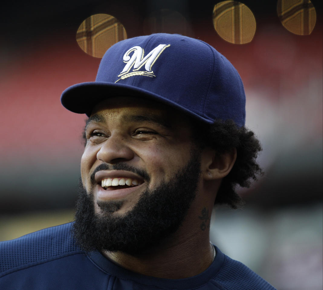 Milwaukee Brewers' Prince Fielder smiles during batting practice before Game 5 of baseball's National League championship series against the St. Louis Cardinals Friday, Oct. 14, 2011, in St. Louis. (AP Photo/Matt Slocum)