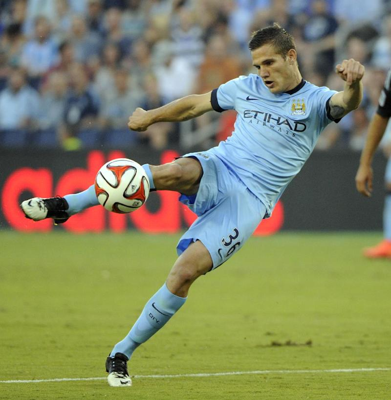 Manchester City FC midfielder Bruno Zuculini scores against Sporting Kansas City during an exhibition match at Sporting Park on July 23, 2014 in Kansas City, Kansas