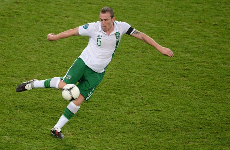 Irish defender Richard Dunne controls the ball during the Euro 2012 football championships match Italy vs Republic of Ireland on June 18, 2012 at the Municipal Stadium in Poznan