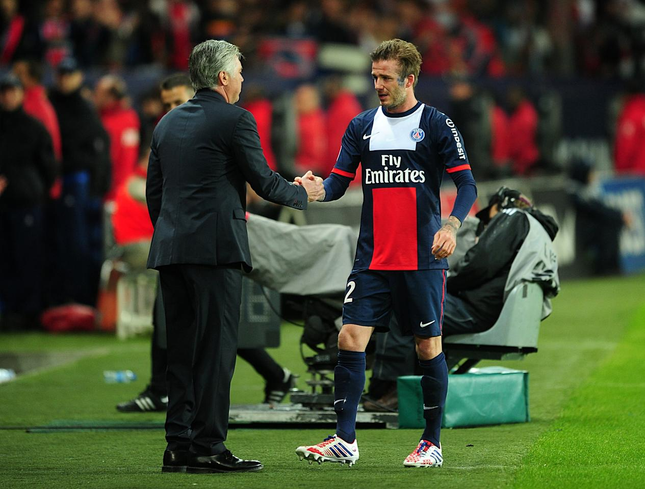 Paris Saint-Germain's David Beckham (right) is substituted and shakes hands with manager Carlo Ancelotti